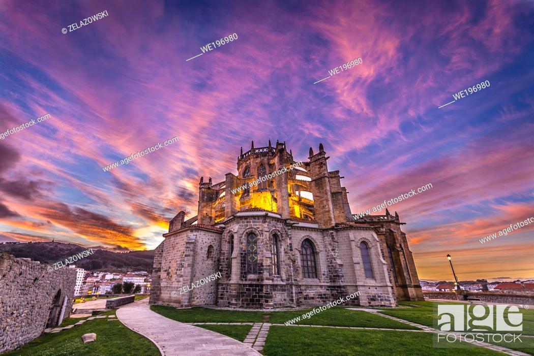 Stock Photo: Church of Santa Maria de la Asuncion in Castro Urdiales seaport in Cantabria region of Spain, view with San Pedro hermitage ruins on left.