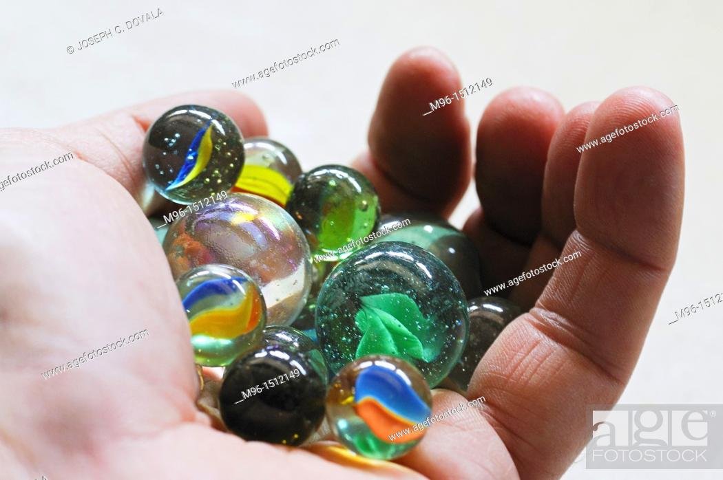 Stock Photo: Hand full of marbles.