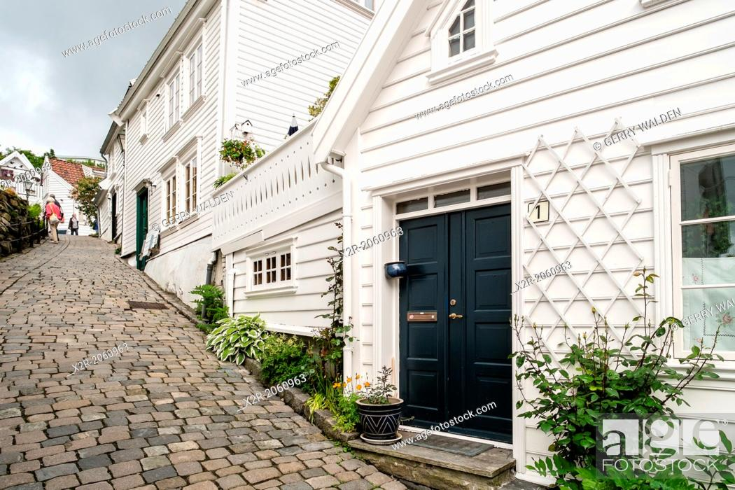 Stock Photo: A cobbled street leading through the beautiful old town part of Stavanger in Norway.