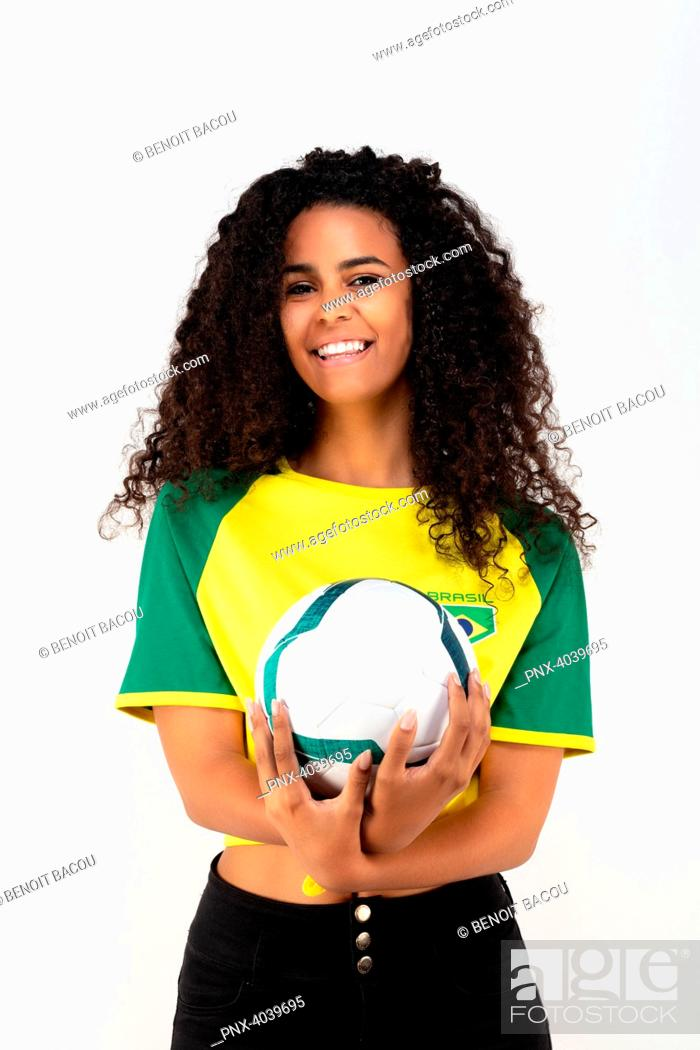 Stock Photo: Portrait of a young supporter of the Brazilian team, a ball in his hands.