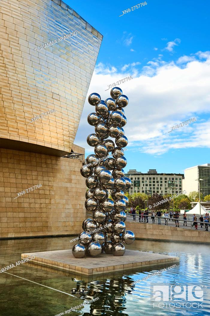 Stock Photo: Sculpture at Guggenheim Museum, Bilbao, Tall Tree and the Eye by Anish Kapoor.