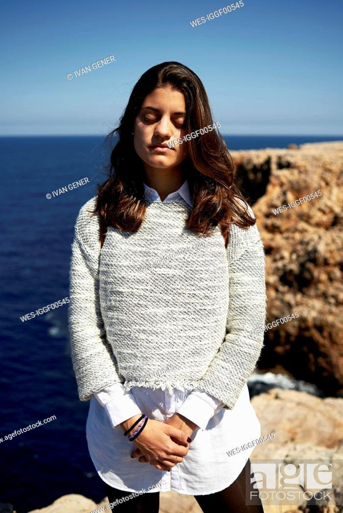 Stock Photo: Feeling the wind, portrait of young brunette woman outdoor.