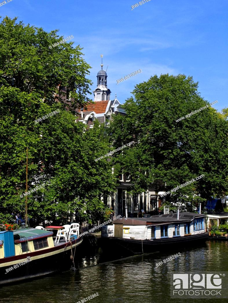 Stock Photo: canal in Amsterdam with trees and houseboats, Netherlands, Amsterdam.