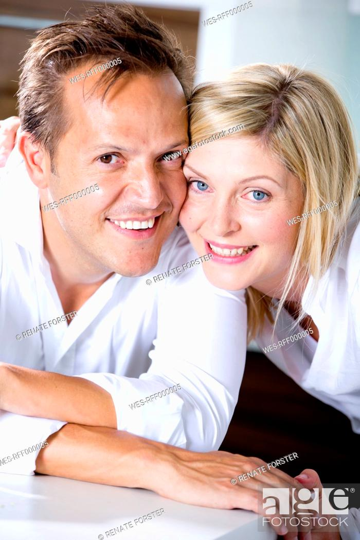 Stock Photo: Germany, Mid adult couple smiling, close-up.