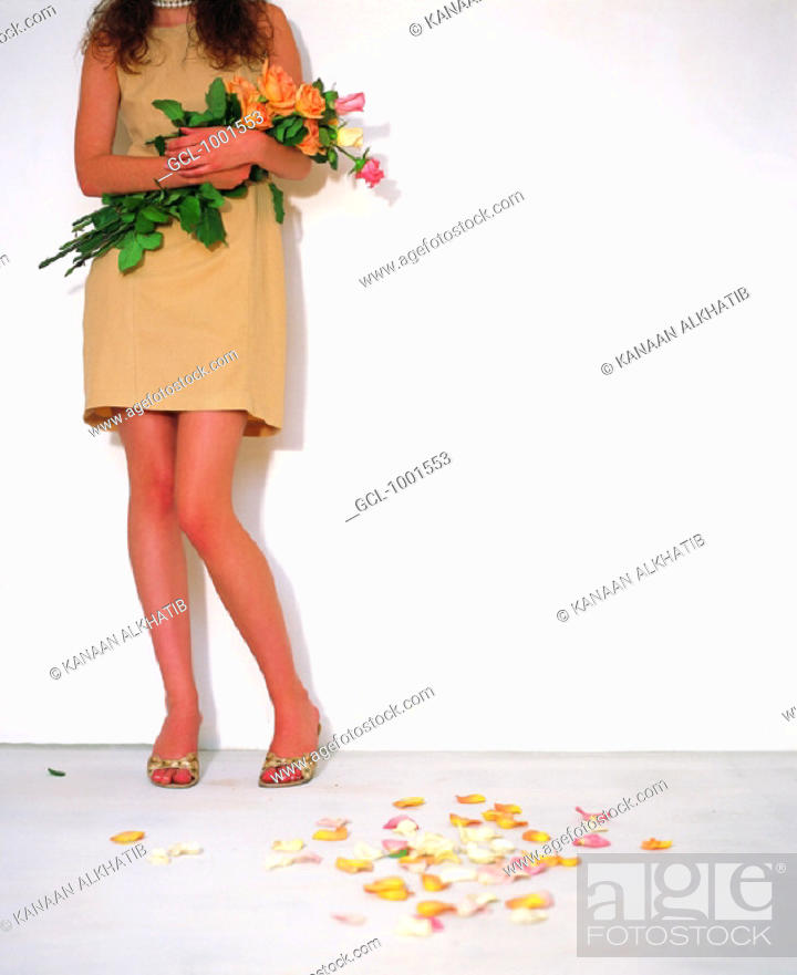 Stock Photo: Woman with bunch of flowers.