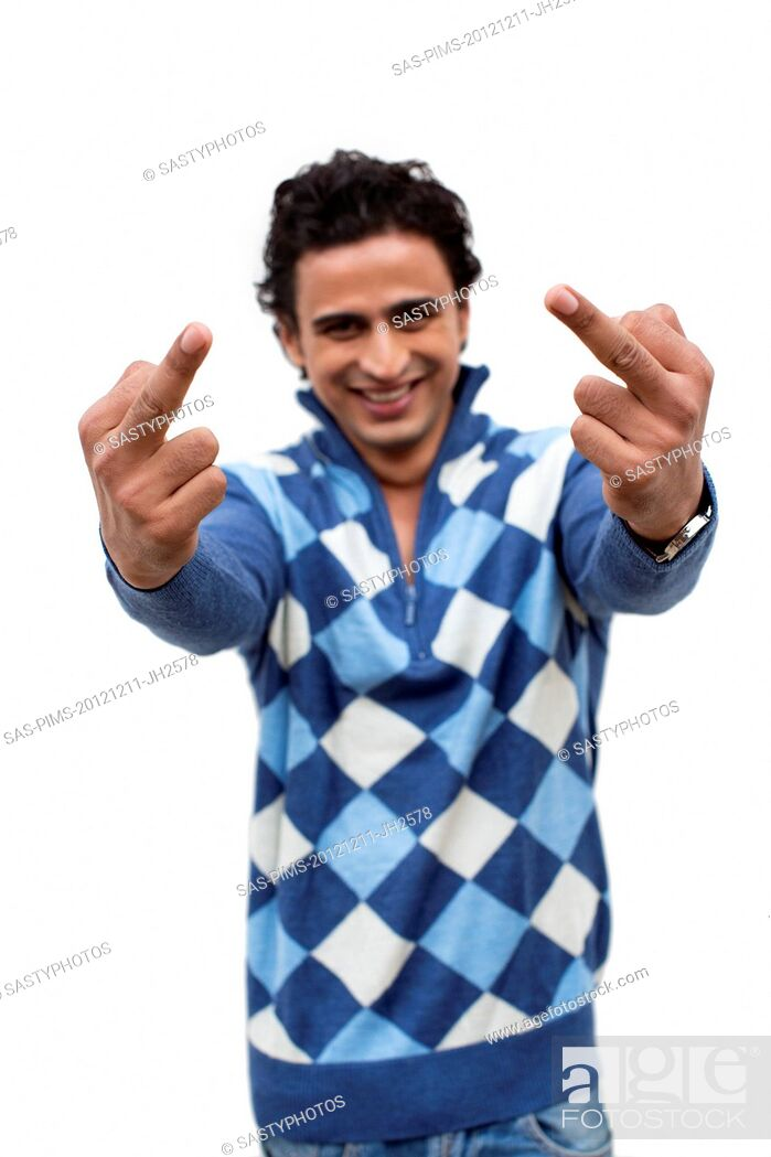 Stock Photo: Portrait of a smiling man showing middle fingers.