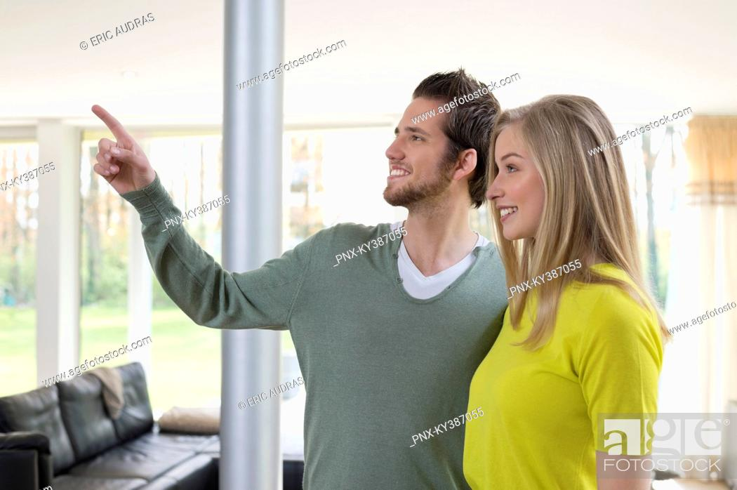 Stock Photo: Man showing house interiors to a woman.