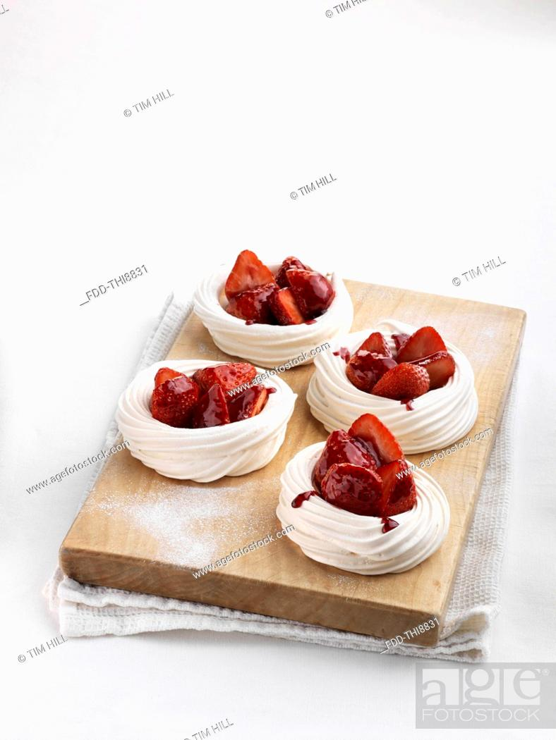 Stock Photo: Strawberry meringue nests.