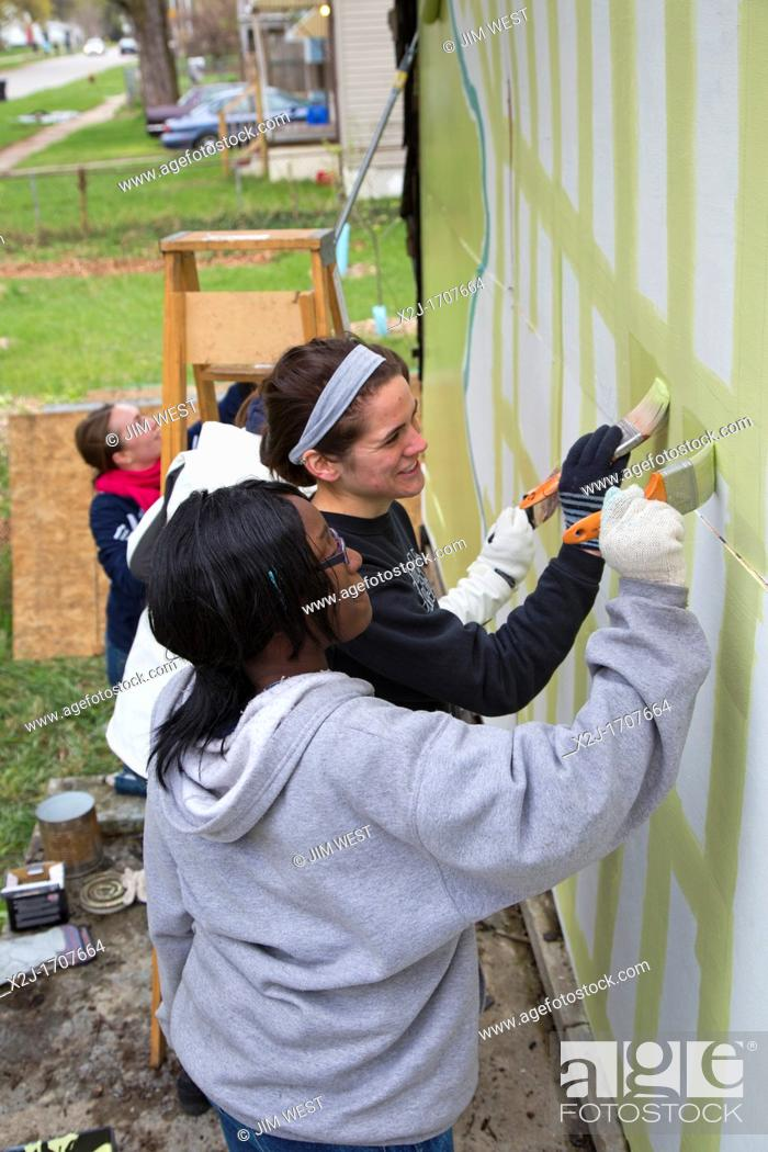 Stock Photo: Detroit, Michigan - Students from the University of Michigan School of Art & Design decorate an abandoned house in the city's Brightmoor neighborhood  The house.