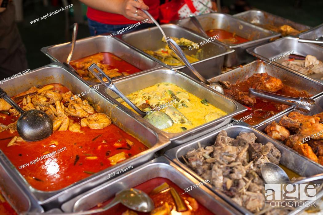 Stock Photo: Street food buffet wirth chicken and various curries, Petaling Street, Chinatown, Kuala Lumpur, Malaysia.