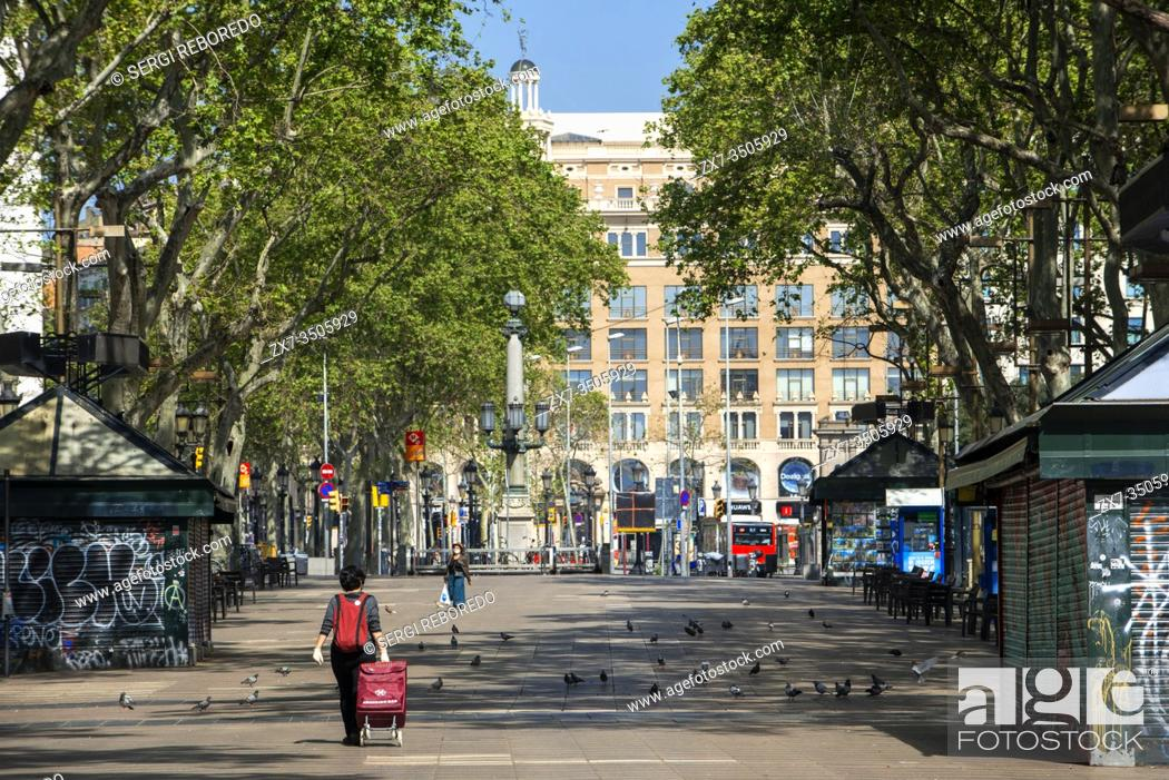 Stock Photo: The Ramblas in Barcelona is practically deserted due to the total confinement of the population in Spain. Spain is one of the countries most affected by the.
