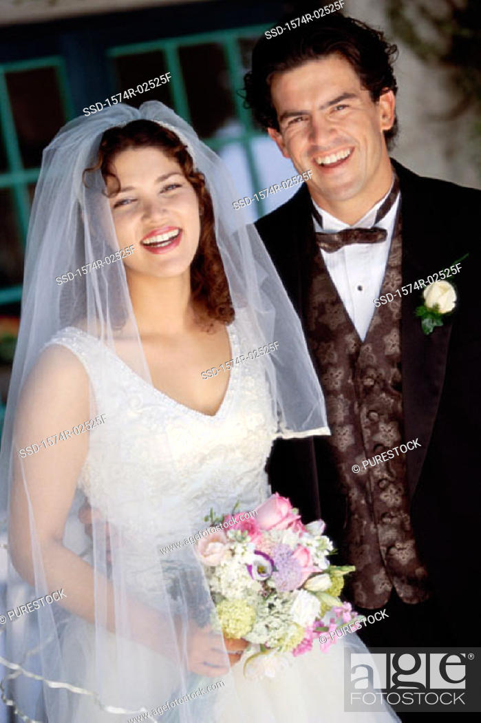 Stock Photo: Portrait of a newlywed couple smiling.
