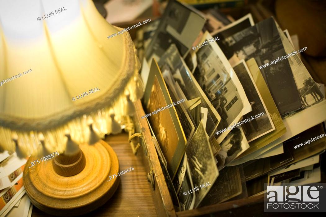 Stock Photo: Lamp and old photos.