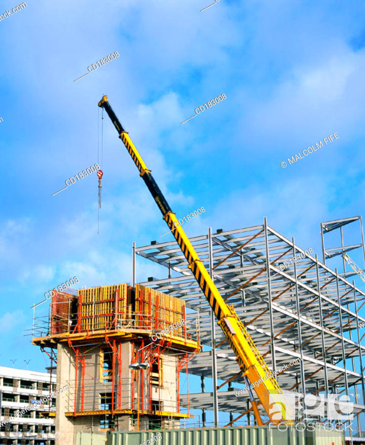 Stock Photo: Crane and block of flats under construction.