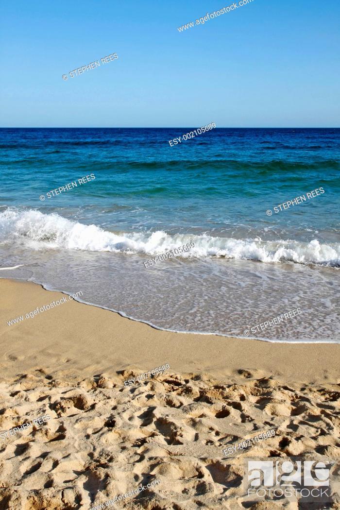Stock Photo: Waves reaching Porthcurno beach in Cornwall UK.