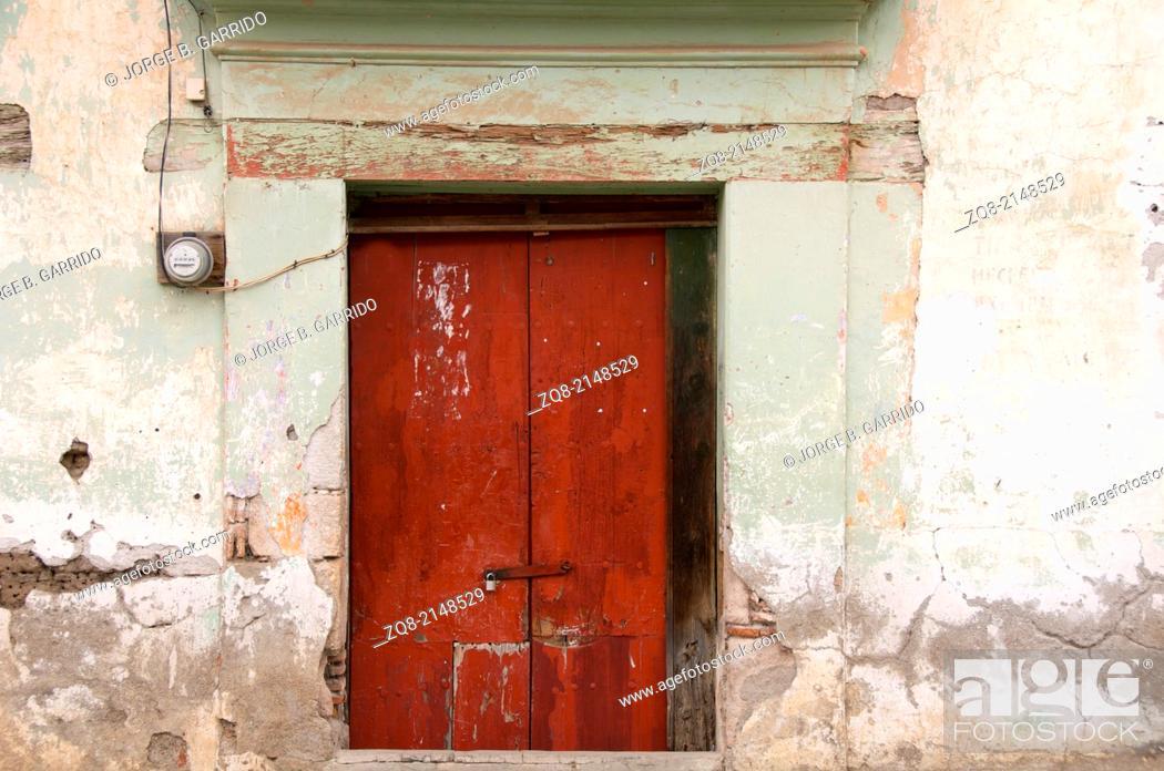Stock Photo: Wooden beautiful door in an old building, Oaxaca Mexico.