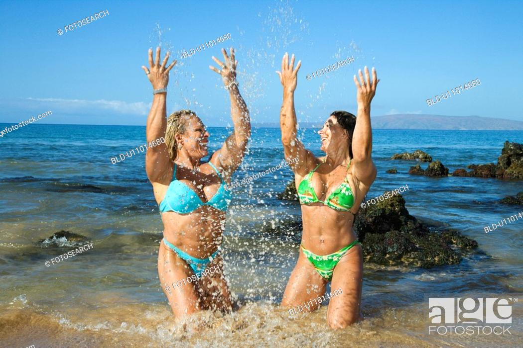 Stock Photo: Women bodybuilders on beach.
