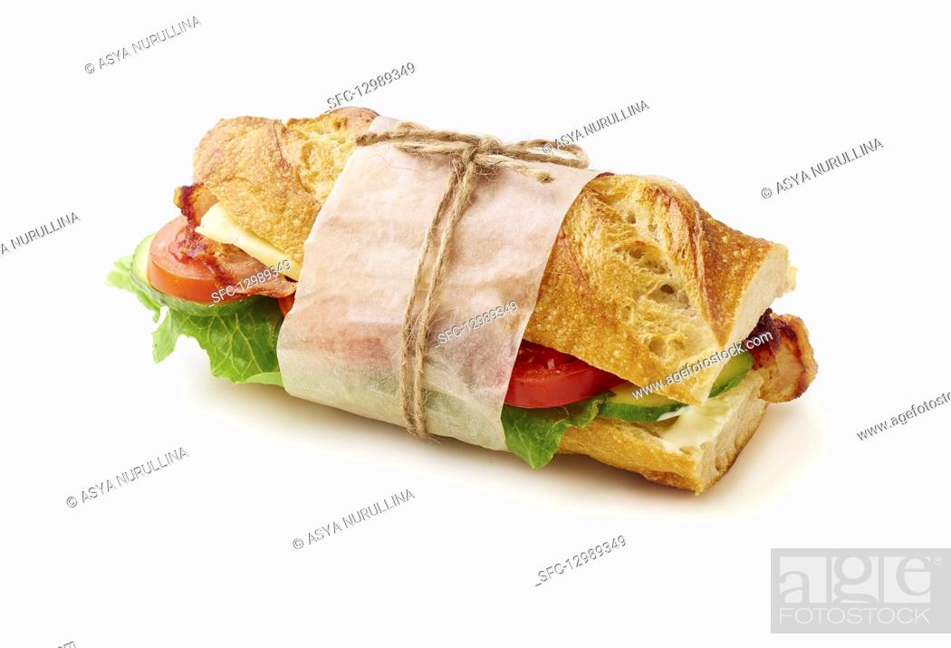 Stock Photo: Fresh big baguette sandwich with bacon, chedder cheese, mustard, lettuce and vegetables.