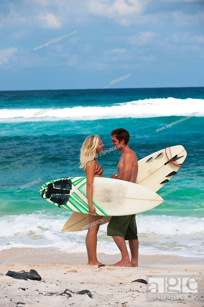 Stock Photo: A couple of surfers in conversation on the beach.