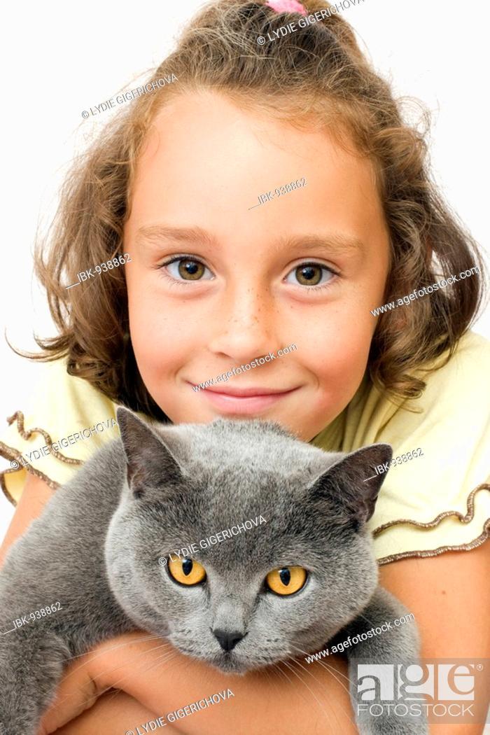Stock Photo: Girl, 6 years, with blue British Shorthair Cat.