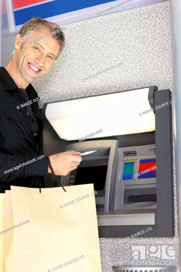 Stock Photo: Man at cashpoint.