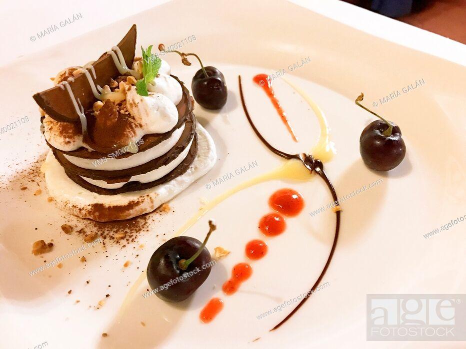Stock Photo: Chocolate cake and cream dessert.