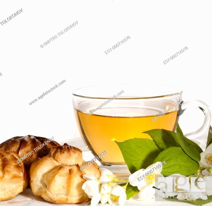 Stock Photo: cup of herbal jasmine tea with éclair.