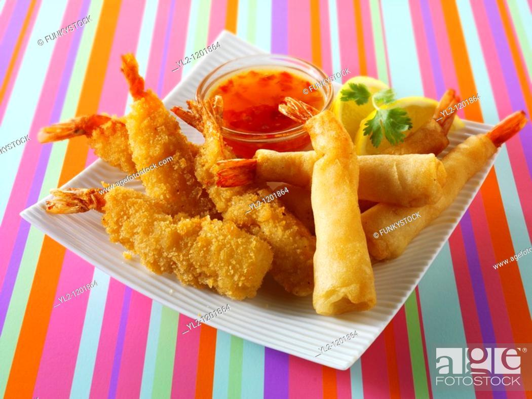 Stock Photo: chinese starters - deep fried breaded prawns  spring rolls, dim sum, and samosas.