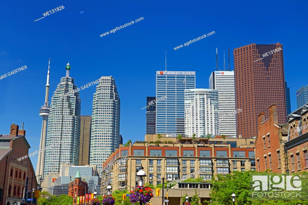 Stock Photo: St Lawrence Market and Gooderham Flatiron building with CN tower and financial district bank towers Toronto at half moon.