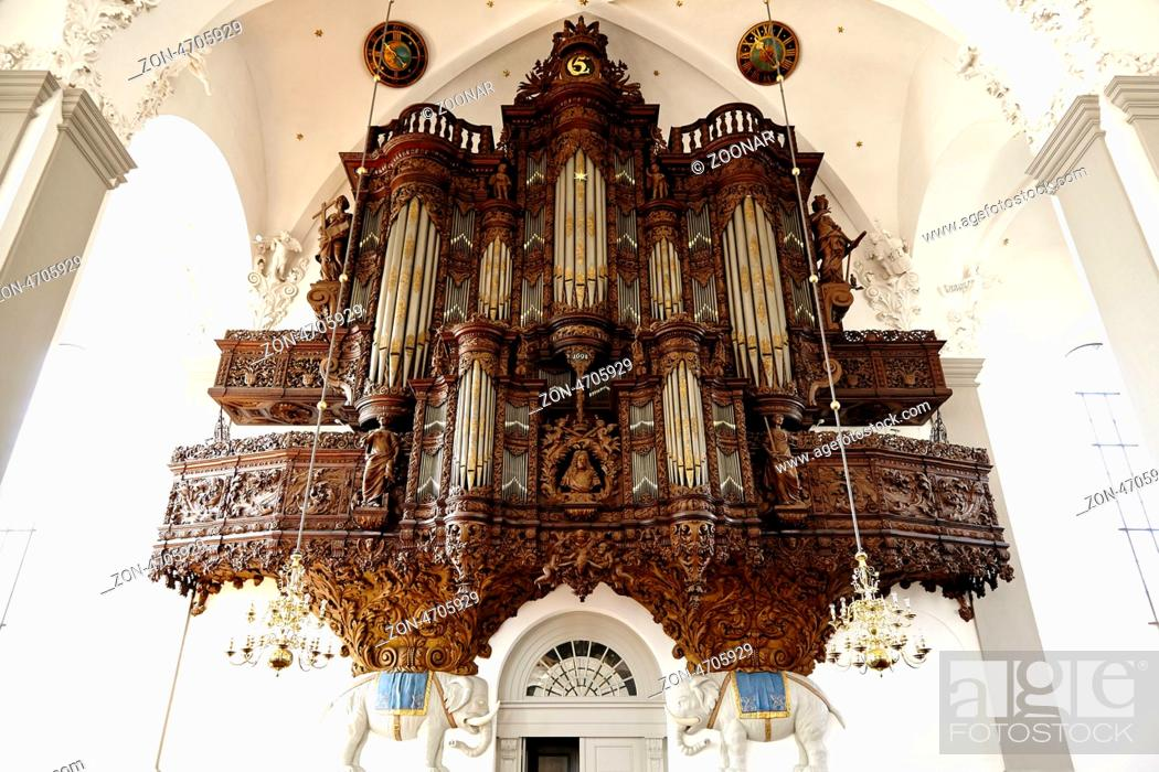 Stock Photo: The organ inside the Vor Frelsers Kirke has Christian V's gilded monogram and was built by from 1698-1700 and is supported by two elephants.