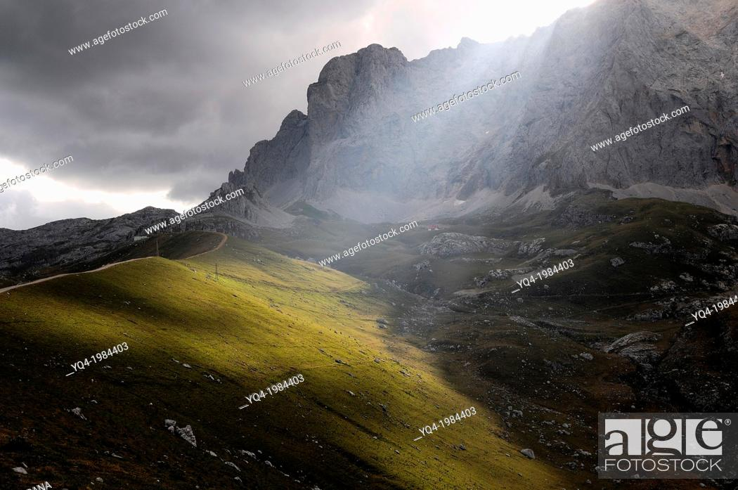 Stock Photo: Light seeps behind the Pico Peña Vieja, illuminating the Valley moraine Duje.Picos Europe, Asturias, Spain.