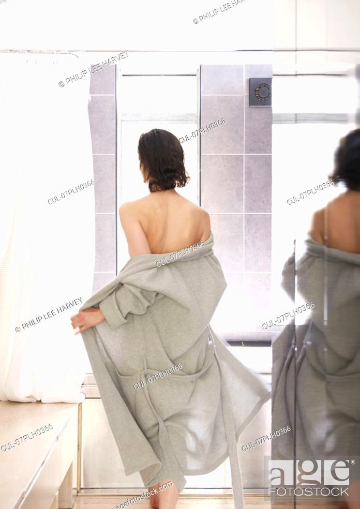Stock Photo: Woman heading to shower in bathrobe.