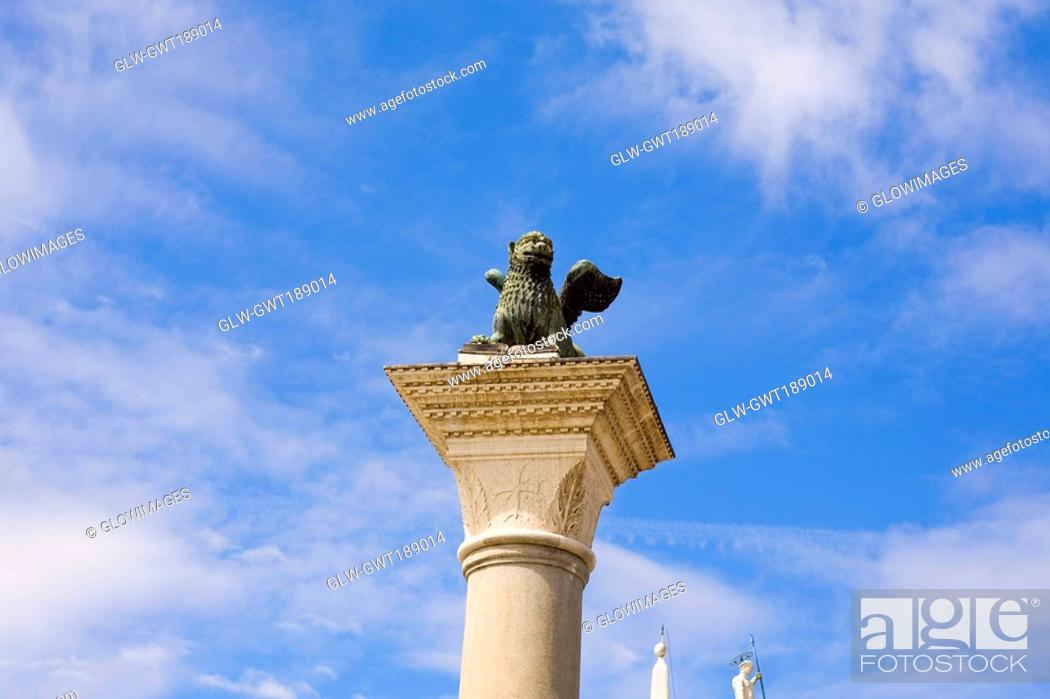 Stock Photo: Statue of winged lion on a column, St  Mark's Square, Venice, Italy.