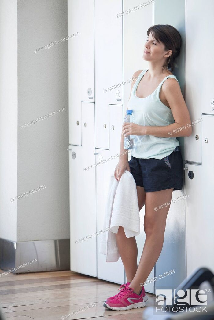 Stock Photo: Woman relaxing in locker room after a workout.