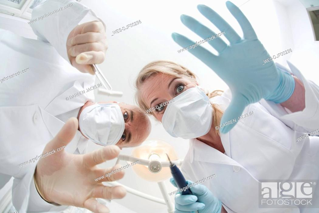 Stock Photo: Germany, Bavaria, Landsberg, Dentist and Female Dentist, low angle view, portrait.