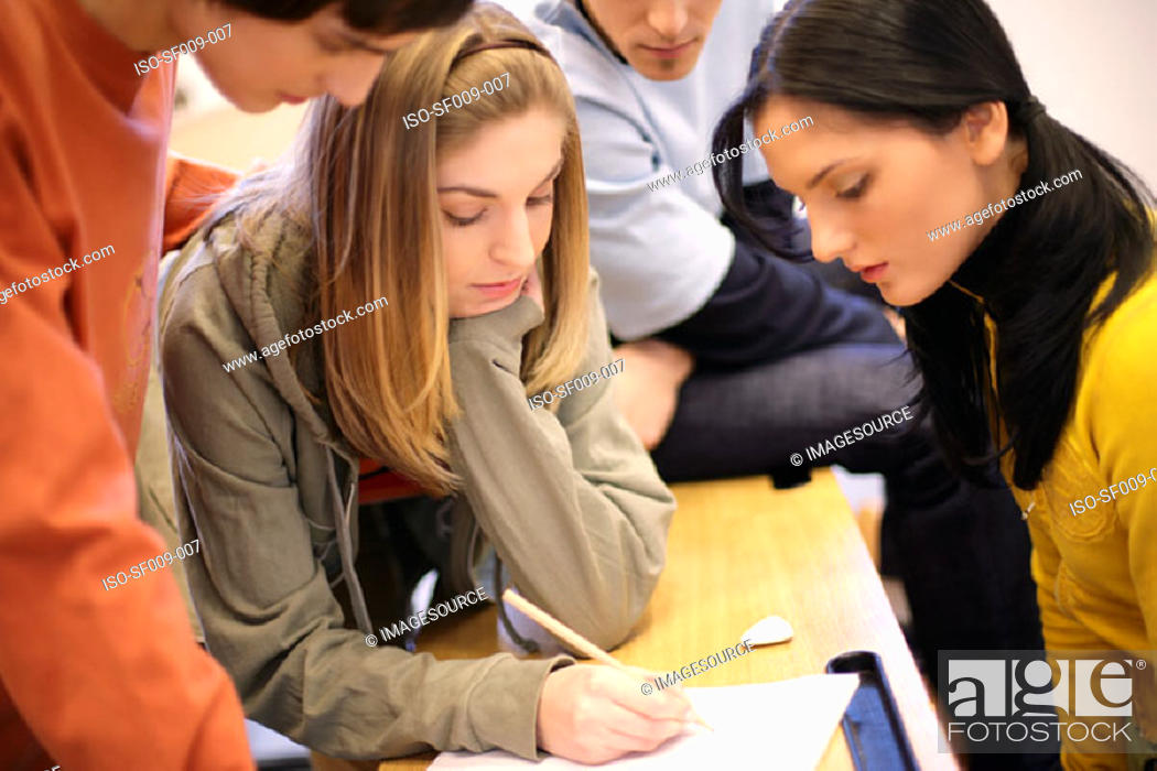 Stock Photo: Young people studying.