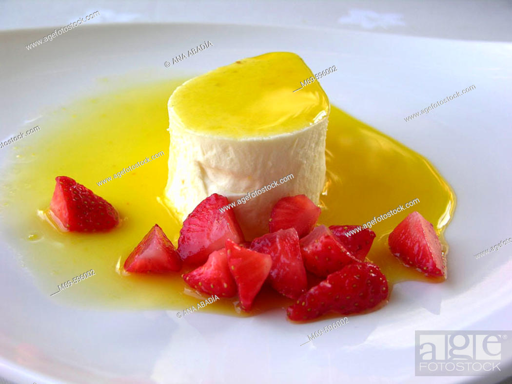 Stock Photo: Mousse of tangerines with strawberries.