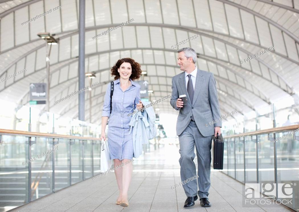 Stock Photo: Business people walking together.