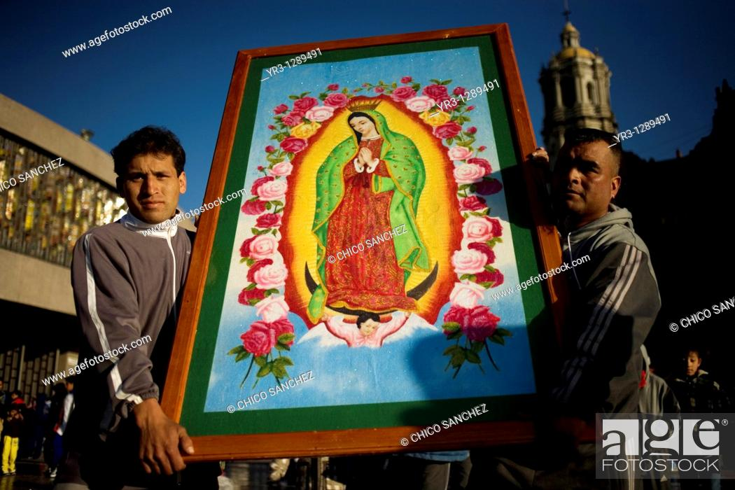 Stock Photo: Pilgrims carry an image of the Our Lady of Guadalupe in Mexico City, December 10, 2010  Hundreds of thousands of Mexican pilgrims converged on the Our Lady of.