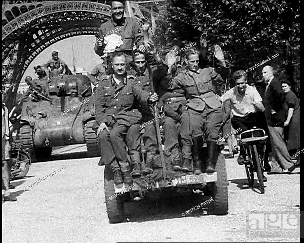 Stock Photo: German Prisoners Of War Being Driven Past the Eiffel Tower In Paris - Paris, French Republic, France.