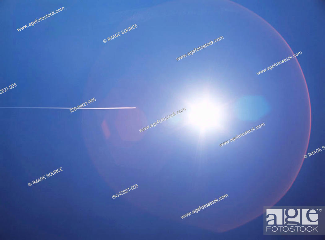 Stock Photo: Sky with sun and vapour trail.