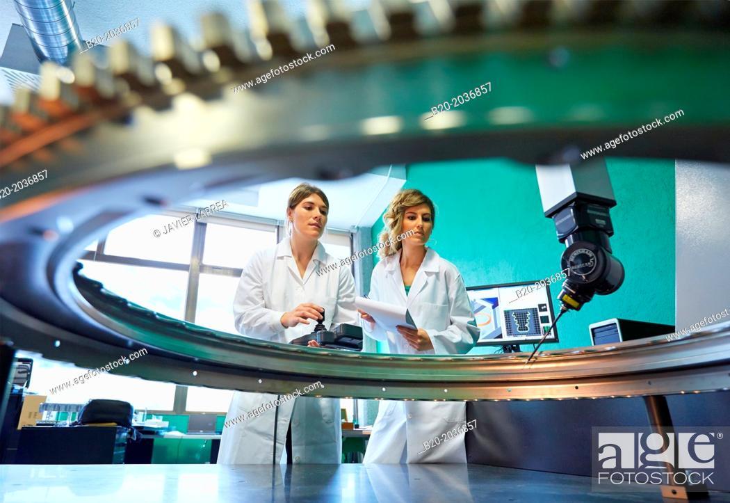 Stock Photo: Technicians inspecting aircraft component. Measurement of a piece in CMM. Coordinate Measuring Machine. Innovative Metrology applied. Sariki Metrology.