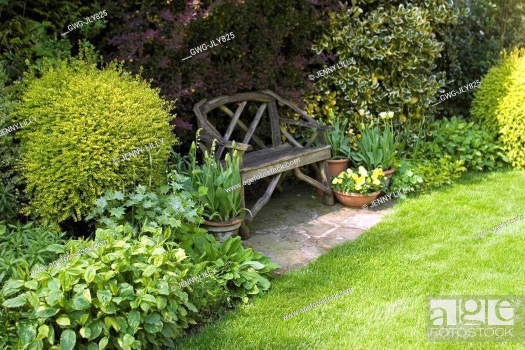 Stock Photo: SEATING AREA IN SHADE AT ASHOVER STREETLY NGS MAY.