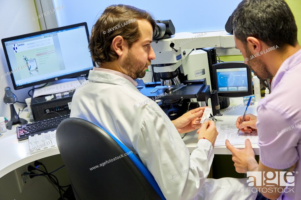 Stock Photo: Analysis with a microscope to detect the presence of the virus (HPV test), or detect minimal more important cellular alterations suggestive of premalignant.