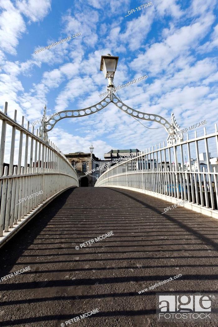 Stock Photo: dublin, ireland, the ha'penny bridge spanning the river liffey.