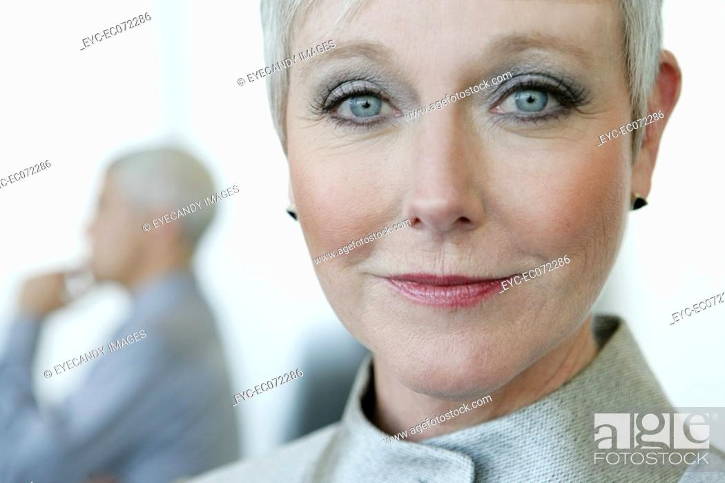 Stock Photo: Portrait of mature woman at airport.