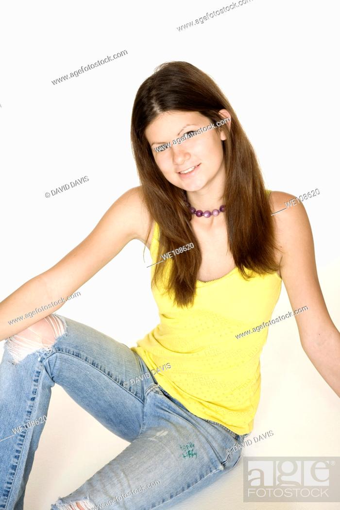 Stock Photo: Teenage girl posing on a white background.
