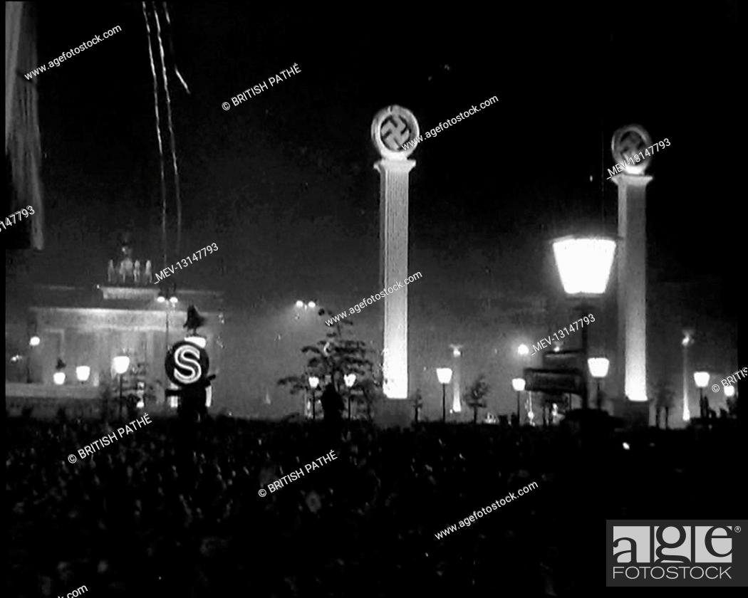Stock Photo: Wide Shot of Pariser Platz and the Brandenburg Gate in Berlin With Large Crowds Showing An Illuminated S Subway Sign on the Left.