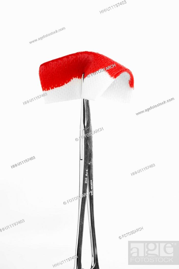 Stock Photo: Tweezers holding blood stained swab (close-up).