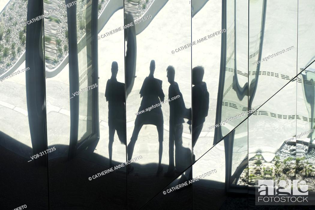 Stock Photo: Four morphed figure reflections in the mirror sections of the mediterranean and archeological gardens at the Roman Museum, Nimes, Provence, France.